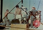 Image of Hoisting of Gadget atomic bomb before Trinity nuclear test Alamogordo New Mexico USA, 1945, second 25 stock footage video 65675072463