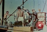 Image of Hoisting of Gadget atomic bomb before Trinity nuclear test Alamogordo New Mexico USA, 1945, second 26 stock footage video 65675072463