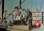 Image of Hoisting of Gadget atomic bomb before Trinity nuclear test Alamogordo New Mexico USA, 1945, second 27 stock footage video 65675072463