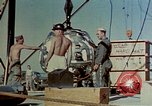 Image of Hoisting of Gadget atomic bomb before Trinity nuclear test Alamogordo New Mexico USA, 1945, second 28 stock footage video 65675072463