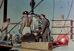 Image of Hoisting of Gadget atomic bomb before Trinity nuclear test Alamogordo New Mexico USA, 1945, second 29 stock footage video 65675072463