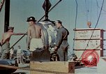 Image of Hoisting of Gadget atomic bomb before Trinity nuclear test Alamogordo New Mexico USA, 1945, second 30 stock footage video 65675072463