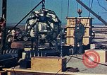 Image of Hoisting of Gadget atomic bomb before Trinity nuclear test Alamogordo New Mexico USA, 1945, second 39 stock footage video 65675072463