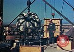 Image of Hoisting of Gadget atomic bomb before Trinity nuclear test Alamogordo New Mexico USA, 1945, second 40 stock footage video 65675072463