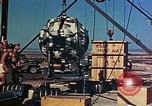 Image of Hoisting of Gadget atomic bomb before Trinity nuclear test Alamogordo New Mexico USA, 1945, second 46 stock footage video 65675072463