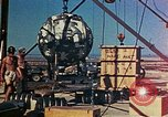 Image of Hoisting of Gadget atomic bomb before Trinity nuclear test Alamogordo New Mexico USA, 1945, second 49 stock footage video 65675072463