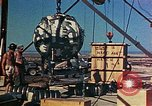 Image of Hoisting of Gadget atomic bomb before Trinity nuclear test Alamogordo New Mexico USA, 1945, second 50 stock footage video 65675072463
