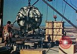 Image of Hoisting of Gadget atomic bomb before Trinity nuclear test Alamogordo New Mexico USA, 1945, second 51 stock footage video 65675072463