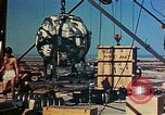 Image of Hoisting of Gadget atomic bomb before Trinity nuclear test Alamogordo New Mexico USA, 1945, second 52 stock footage video 65675072463