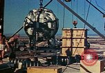 Image of Hoisting of Gadget atomic bomb before Trinity nuclear test Alamogordo New Mexico USA, 1945, second 53 stock footage video 65675072463