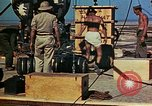 Image of Hoisting of Gadget atomic bomb before Trinity nuclear test Alamogordo New Mexico USA, 1945, second 59 stock footage video 65675072463