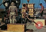 Image of Hoisting of Gadget atomic bomb before Trinity nuclear test Alamogordo New Mexico USA, 1945, second 60 stock footage video 65675072463
