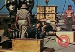 Image of Hoisting of Gadget atomic bomb before Trinity nuclear test Alamogordo New Mexico USA, 1945, second 61 stock footage video 65675072463