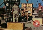 Image of Hoisting of Gadget atomic bomb before Trinity nuclear test Alamogordo New Mexico USA, 1945, second 62 stock footage video 65675072463