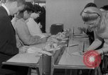 Image of civilians purchase lottery tickets New York City USA, 1967, second 27 stock footage video 65675072485