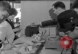 Image of civilians purchase lottery tickets New York City USA, 1967, second 37 stock footage video 65675072485