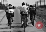 Image of 60 mile bicycle race Chicago Illinois USA, 1936, second 32 stock footage video 65675072520
