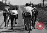 Image of 60 mile bicycle race Chicago Illinois USA, 1936, second 34 stock footage video 65675072520