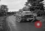 Image of U.S.4th Armored Division in Operation Cobra in World War II Periers France, 1944, second 62 stock footage video 65675072546