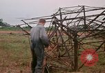 Image of recovery of LB-7 aircraft Bluefields Nicaragua, 1969, second 26 stock footage video 65675072639