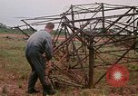 Image of recovery of LB-7 aircraft Bluefields Nicaragua, 1969, second 29 stock footage video 65675072639