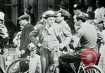 Image of French civilians listen to German propaganda broadcast Paris France, 1940, second 23 stock footage video 65675072694