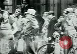 Image of French civilians listen to German propaganda broadcast Paris France, 1940, second 25 stock footage video 65675072694