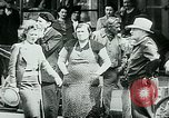 Image of French civilians listen to German propaganda broadcast Paris France, 1940, second 27 stock footage video 65675072694