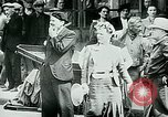 Image of French civilians listen to German propaganda broadcast Paris France, 1940, second 28 stock footage video 65675072694