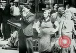 Image of French civilians listen to German propaganda broadcast Paris France, 1940, second 29 stock footage video 65675072694