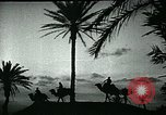 Image of Camels in Muslim lands of  Eurasia and Africa Middle East, 1936, second 42 stock footage video 65675072698