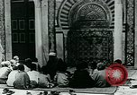 Image of Madrassa Islamic school outside a mosque Middle East, 1936, second 14 stock footage video 65675072701