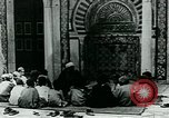 Image of Madrassa Islamic school outside a mosque Middle East, 1936, second 15 stock footage video 65675072701