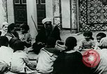 Image of Madrassa Islamic school outside a mosque Middle East, 1936, second 17 stock footage video 65675072701