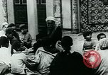 Image of Madrassa Islamic school outside a mosque Middle East, 1936, second 18 stock footage video 65675072701