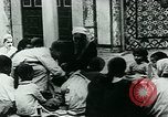 Image of Madrassa Islamic school outside a mosque Middle East, 1936, second 19 stock footage video 65675072701