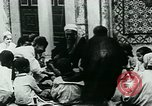 Image of Madrassa Islamic school outside a mosque Middle East, 1936, second 20 stock footage video 65675072701