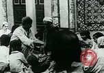 Image of Madrassa Islamic school outside a mosque Middle East, 1936, second 21 stock footage video 65675072701