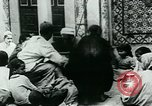 Image of Madrassa Islamic school outside a mosque Middle East, 1936, second 22 stock footage video 65675072701