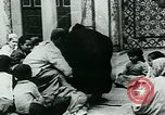 Image of Madrassa Islamic school outside a mosque Middle East, 1936, second 23 stock footage video 65675072701