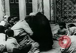 Image of Madrassa Islamic school outside a mosque Middle East, 1936, second 24 stock footage video 65675072701