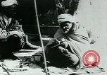 Image of Madrassa Islamic school outside a mosque Middle East, 1936, second 56 stock footage video 65675072701