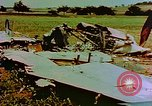Image of German farmers work aroung a crashed U.S. Air Force P-47 in a field Germany, 1945, second 4 stock footage video 65675072706