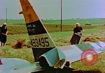 Image of German farmers work aroung a crashed U.S. Air Force P-47 in a field Germany, 1945, second 12 stock footage video 65675072706