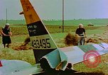 Image of German farmers work aroung a crashed U.S. Air Force P-47 in a field Germany, 1945, second 13 stock footage video 65675072706