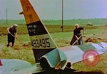Image of German farmers work aroung a crashed U.S. Air Force P-47 in a field Germany, 1945, second 14 stock footage video 65675072706