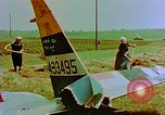 Image of German farmers work aroung a crashed U.S. Air Force P-47 in a field Germany, 1945, second 15 stock footage video 65675072706
