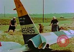 Image of German farmers work aroung a crashed U.S. Air Force P-47 in a field Germany, 1945, second 16 stock footage video 65675072706