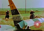 Image of German farmers work aroung a crashed U.S. Air Force P-47 in a field Germany, 1945, second 17 stock footage video 65675072706