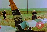 Image of German farmers work aroung a crashed U.S. Air Force P-47 in a field Germany, 1945, second 18 stock footage video 65675072706